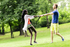 Beautiful couple dancing outdoors in a park Royalty Free Stock Photo