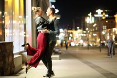 Beautiful couple on a date in a night city. Outdoorr stock images