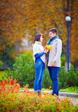 Beautiful couple dating in autumn park Stock Image