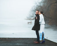 Beautiful couple on the dock in the winter fog. Royalty Free Stock Images