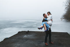 Beautiful couple on the dock in the winter fog. Royalty Free Stock Photo