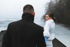 Beautiful couple on the dock in the winter fog. Royalty Free Stock Photos