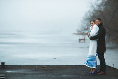Beautiful couple on the dock in the winter fog. Stock Photo