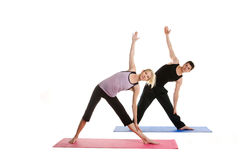 Beautiful Couple Doing Yoga. Man and Woman Doing Yoga on a white background Royalty Free Stock Image