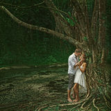 Beautiful couple in dramatic forest Stock Images