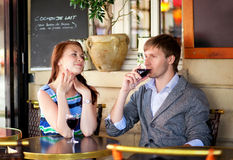 Beautiful couple drinking red wine Stock Photography