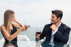 Beautiful couple drinking red wine Stock Photos