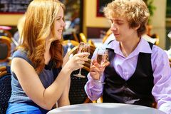 Beautiful couple drinking rose wine Royalty Free Stock Images