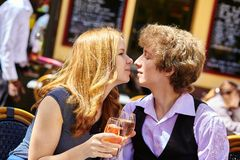 Beautiful couple drinking rose wine Stock Images