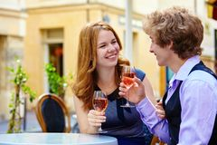 Beautiful couple drinking rose wine Stock Photos