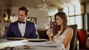 Beautiful couple drinking wine in a restaurant stock video