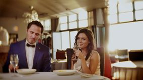 Beautiful couple eating dessert in a restaurant stock video footage