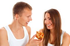 Beautiful couple eating pizza Stock Photography