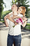 Beautiful couple embrace in the park. Beautiful happy couple embrace in the park Stock Photo