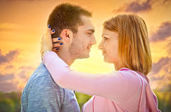 Beautiful couple embracing on date in sunset Royalty Free Stock Photo