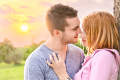 Beautiful couple embracing on date in sunset Royalty Free Stock Images