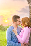 Beautiful couple embracing on date in sunset Royalty Free Stock Photos