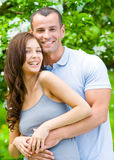 Beautiful couple embracing near blossomed tree Royalty Free Stock Photos