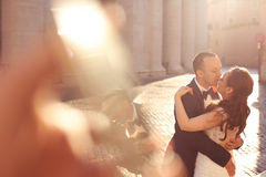 Beautiful couple embracing in old city Stock Images