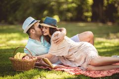 Beautiful couple enjoying picnic time outdoor. Reading book royalty free stock photos