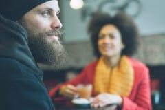 Beautiful couple enjoying tea in a restaurant Stock Images