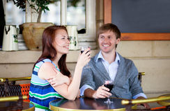 Beautiful couple enjoying their red wine Stock Images