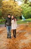 Beautiful couple on a fall day. Beautiful loving couple on a fall day royalty free stock images