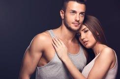 Beautiful couple. Fashion studio photo of beautiful handsome couple in love.Studio fashion portrait. Toned photo stock photo