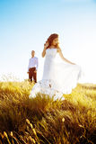 Beautiful couple in field, Lovers or newlywed posing on sunset with perfect sky. Real emotions stock images