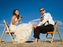 Beautiful couple in front of the blue sky Royalty Free Stock Photos