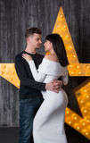 Beautiful couple in front of a glowing star. Man and women are going to become parents. Pregnancy royalty free stock images
