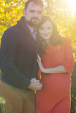 Beautiful couple future parents in sunset lights Royalty Free Stock Photography