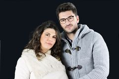 Beautiful couple of future parents in winter clothes Stock Photography