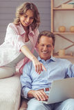 Beautiful couple with gadget Royalty Free Stock Photo