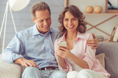 Beautiful couple with gadget Stock Images