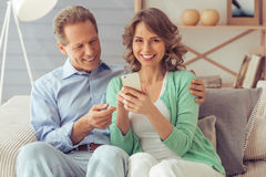 Beautiful couple with gadget Royalty Free Stock Image