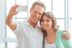 Beautiful couple with gadget Royalty Free Stock Photography