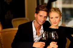 Beautiful couple with glasses of wine Stock Photography