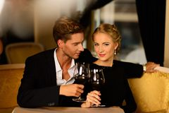 Beautiful couple with glasses of wine Royalty Free Stock Images