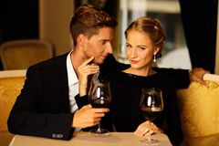 Beautiful couple with glasses of wine Royalty Free Stock Photos