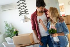 Beautiful couple happy for their new home. And hugging after moving in stock photos