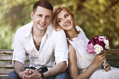 Beautiful couple happy together. Valentines day and love concept.Beautiful couple happy together sitting in park and smiling Stock Photos