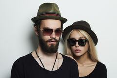 Beautiful couple in hat wearing trendy glasses together. Hipster boy and girl Royalty Free Stock Photos