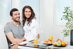 Beautiful couple having breakfast Stock Photos