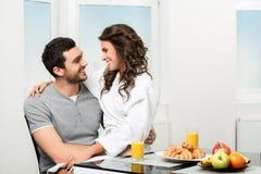 Beautiful couple having breakfast Stock Images