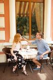 Beautiful couple having coffee on a date,having fun together. Stock Images