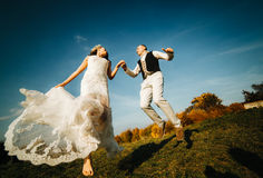 Beautiful couple having fun. On the lawn royalty free stock photography