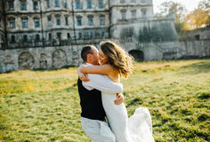Beautiful couple having fun. On the lawn in front of the castle Stock Image