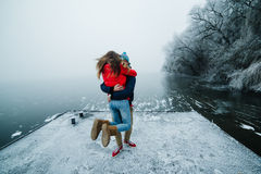 Beautiful couple having fun on the pier Stock Image