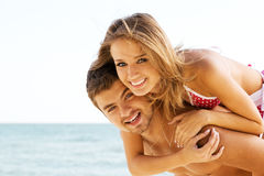 Beautiful couple having fun on the seaside Royalty Free Stock Photography